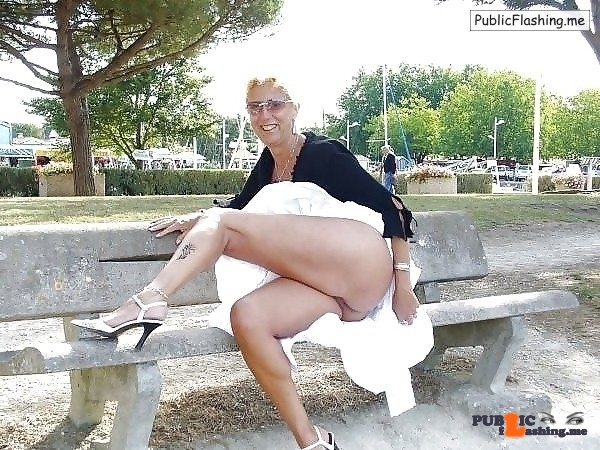 Mature blonde with no panties flashing ass in public park Public Flashing