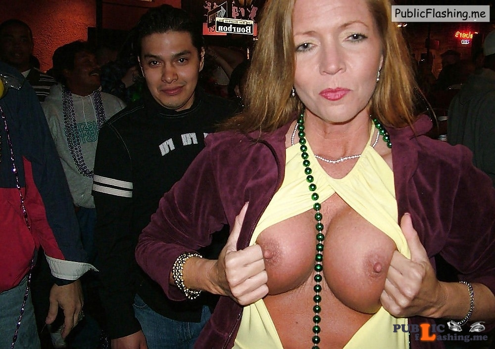 MATURE FLASHING TITS Super sexy MILF surrounded by young guys on the street Public Flashing