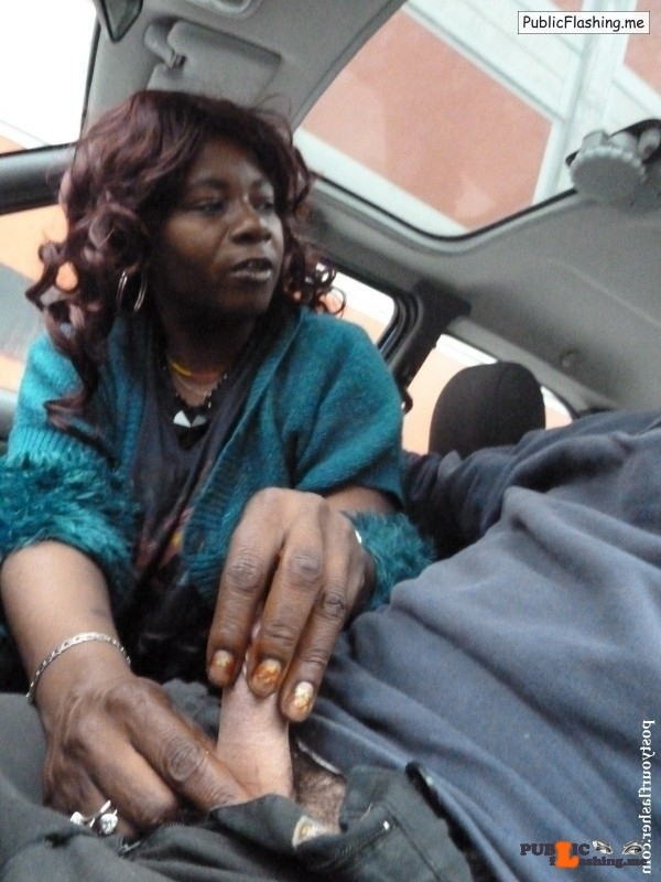 Mature African whore handjob in a car