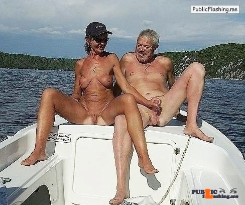Mature couple hanjob on a boat