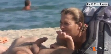Amateur wife is touching husbands boner on nude beach VIDEO Public Flashing