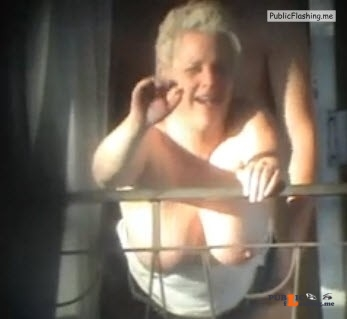 Amateur MILF is waving to voyeur during sex on balcony VIDEO Public Flashing