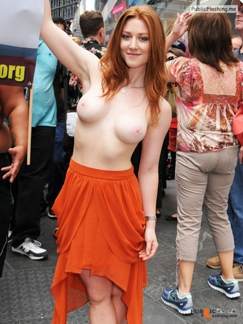 Public nudity photo raptoy:Redhead topless in New york Follow me for more public... Public Flashing