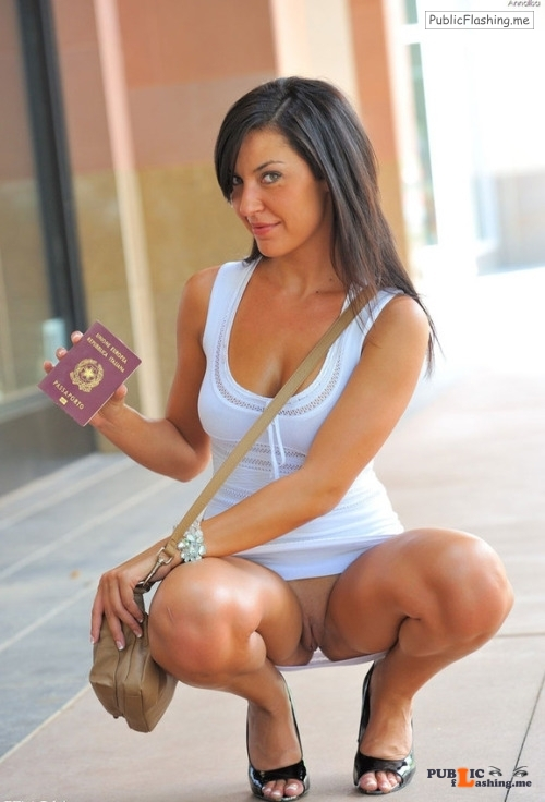 Public flashing photo oramixbottomlessoramix: Proudly showing her passport.  Public Flashing