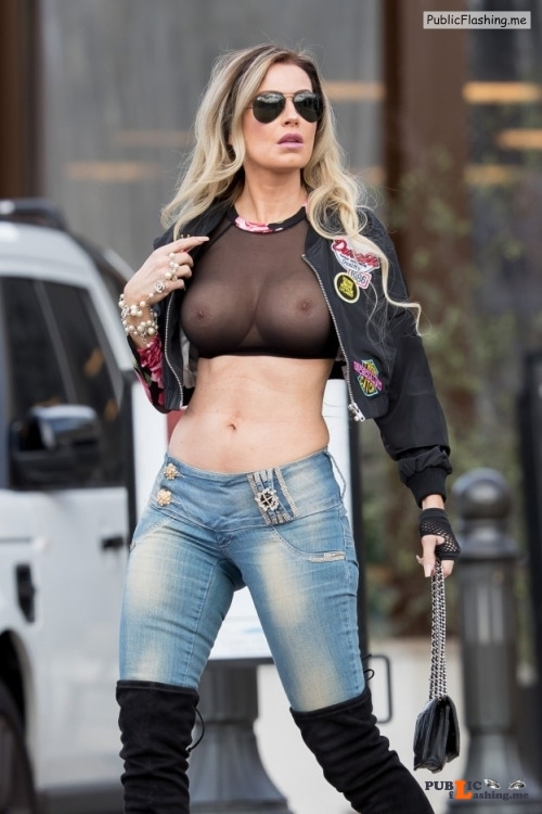 Exposed in public nudeandnaughtycelebs: Ana Braga wears a black sheer top and is... Public Flashing
