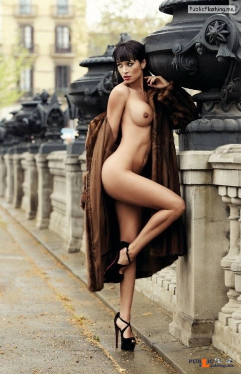 Fully nude dark haired babe posing in fur coat and high heels in public Public Flashing