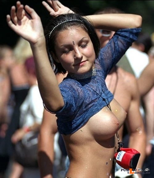 Public nudity photo enf findings:This concert flasher loses herself in the moment... Public Flashing