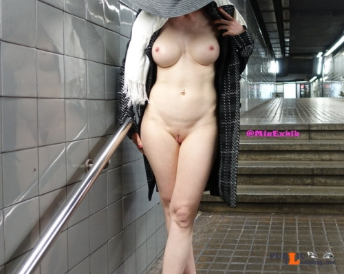 Public flashing photo miaexhib:Naked under my coat in the subway station Public Flashing
