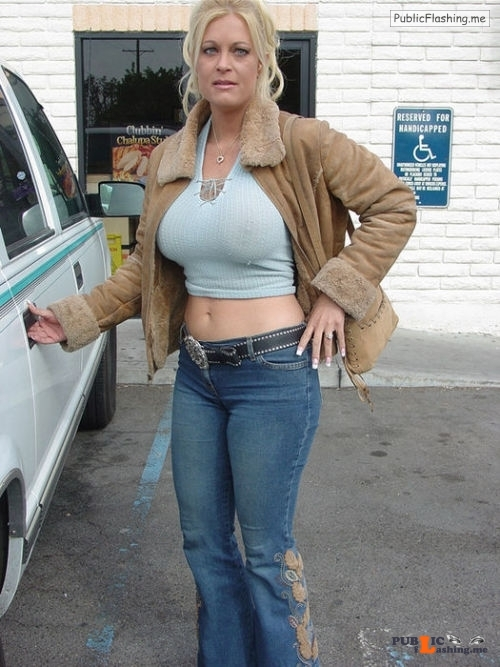 Exposed in public Nice MILF rack… Public Flashing