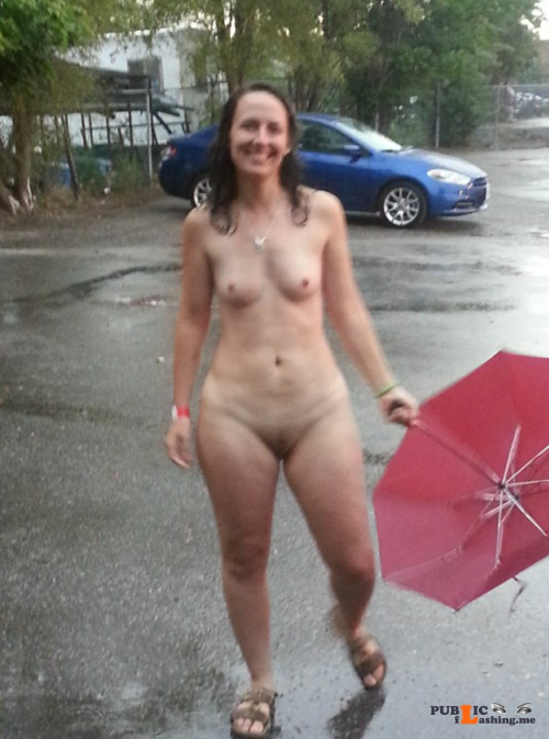 Public flashing photo showitgirl:Brave Milf playing in the rain for... Public Flashing