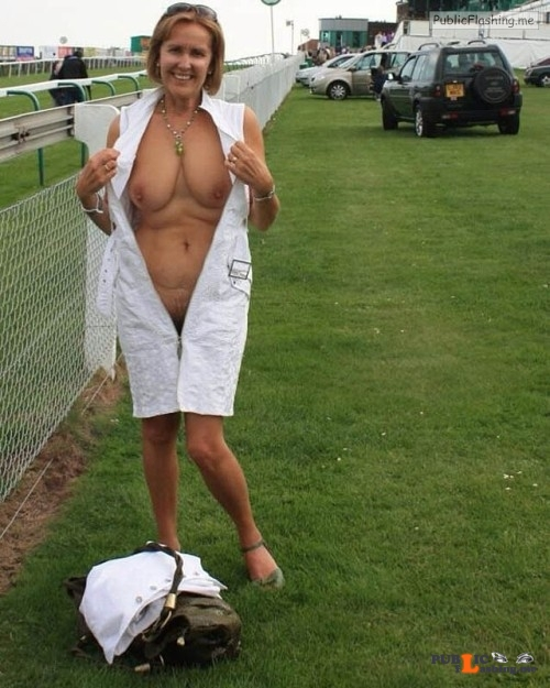 Exposed in public MILF flash at the race track… Public Flashing