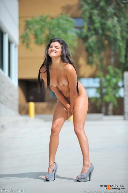 FTV Babes Trisha looks like she is having a ball, naked in public, playing... Public Flashing