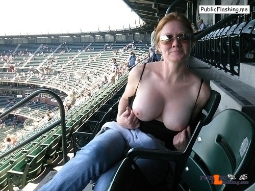Milf flashing big tits on stadium Public Flashing
