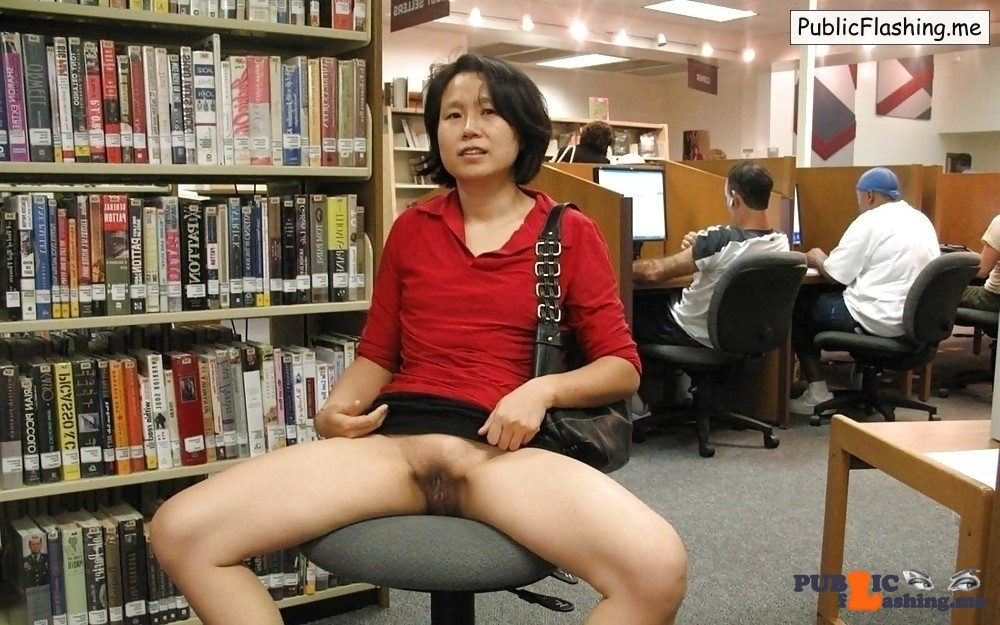 Asian MILF flashing pussy in internet cafe