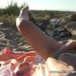 MILF masturbating voyeurs watching on beach VIDEO