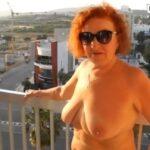 Mature redhead nude on balcony amateur VIDEO