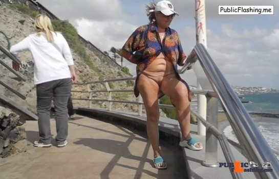 Mature whore flashing near sea VIDEO