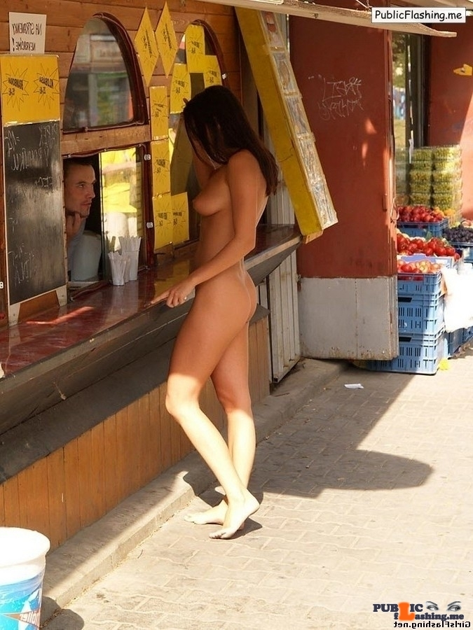 Totally nude brunette is buying fast food