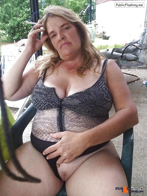 Mature MILF smoking cigarette and flaslashing pussy outdoors