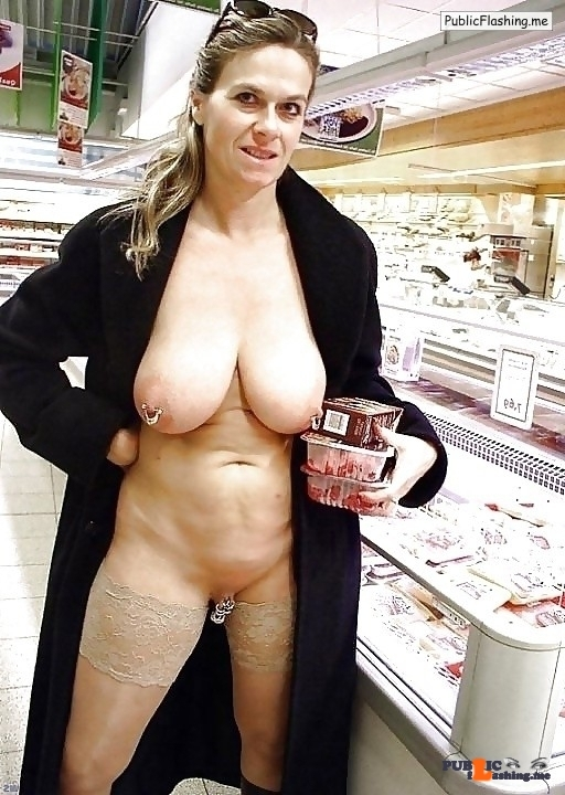 Mature flashing big pieced breasts and pierced cunt in supermarket
