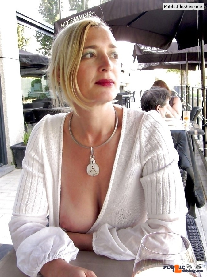 Nice looking blonde MILF nipple slip in outdoor cafe Public Flashing