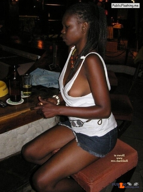 Black nipple slip in a pub Public Flashing