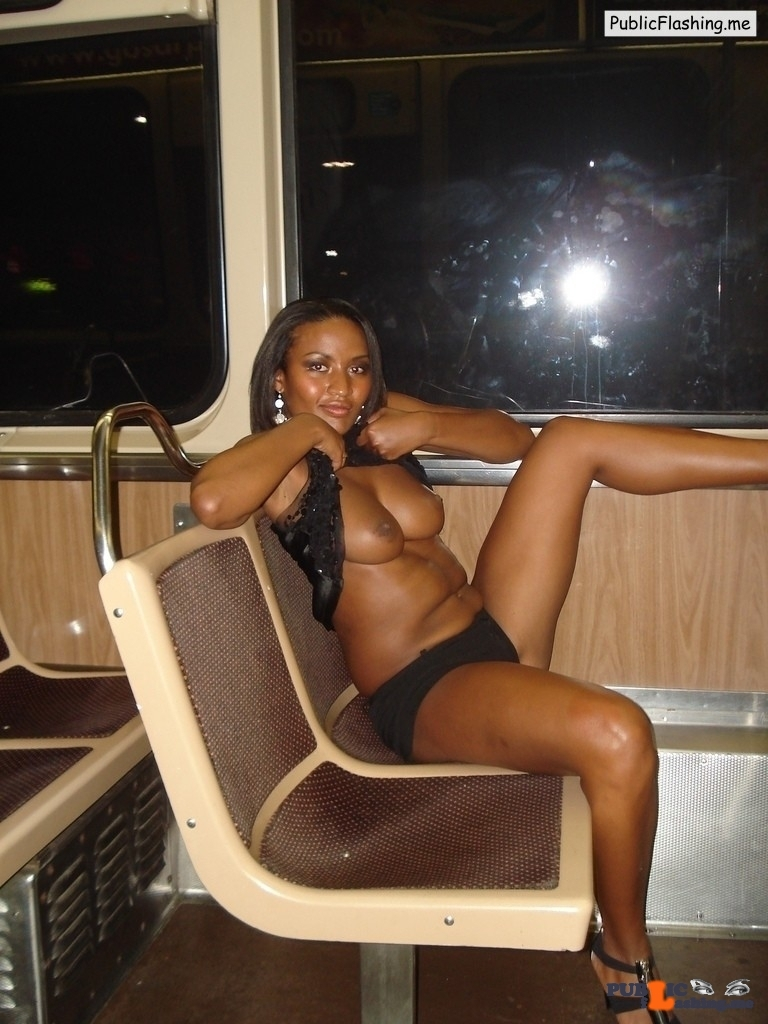 Ebony chick is flashing boobies in public bus