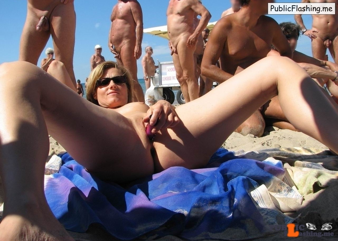 Cougar is masturbating on nude beach for voyeurs