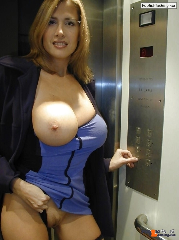 Cougar is flashing big boob and pussy in elevator