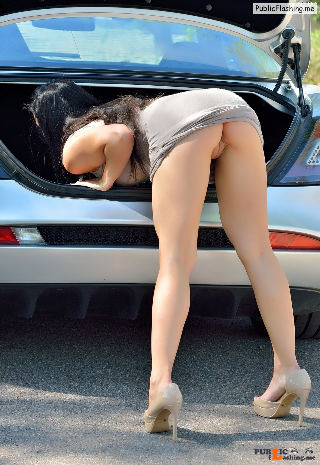 pantieless bend over on parking ass flashing