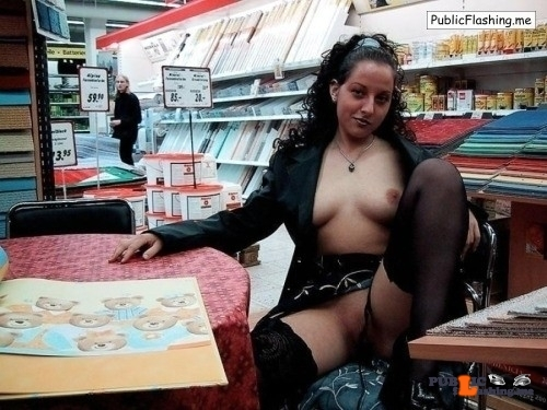 Flashing in public store Looks like the gal in the back is interested in what is going on…