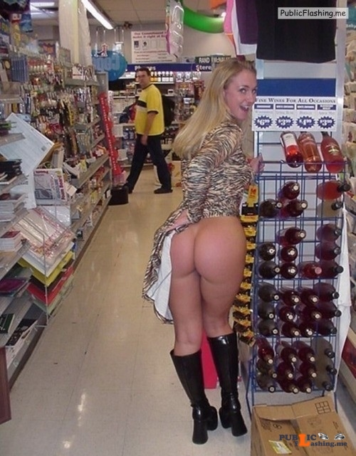 Flashing in public store Awesome ass!  Bet that guy wishes he was at the other end of the... Public Flashing