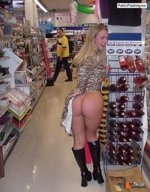 Flashing in public store Awesome ass!  Bet that guy wishes he was at the other end of the…