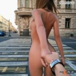 Nude girl crossing street
