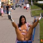 Bare pussy legs high up and big smile while flashing in public street
