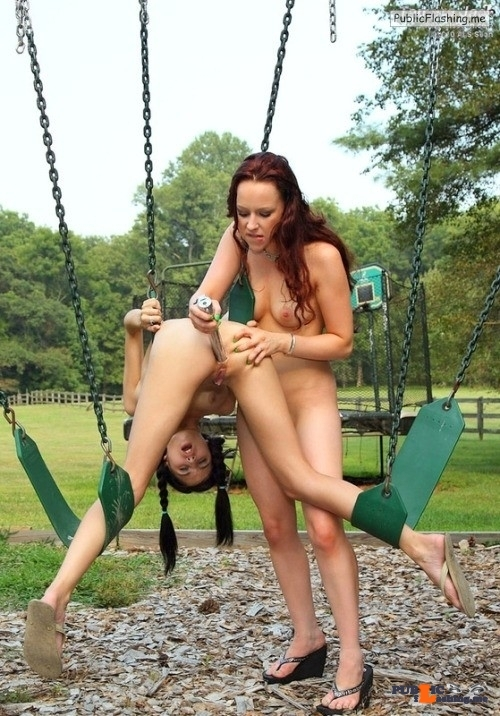 Lesbian redheads dildoing on public swing