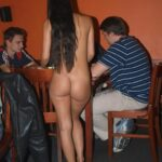 Public nudity photo kinkissx: beautiful naked waitress serving and chatting with…