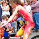 Public nudity photo walkingandswinging: Colorful public CFNM with a mixed…