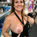 Flashing in public store So much love for naughty wives like this that just whip their…