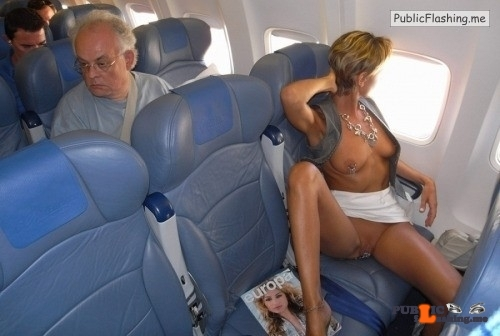 Public flashing photo carelessnaked: Showing both her boobs and pussy in an airplane