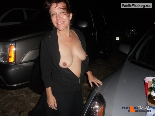 Mature woman flashing saggy tits in the parking lot