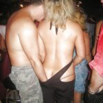 Public nudity photo carelessnaked:In a party and showing her naked back and…