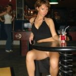 College girlfriend panties down pussy flashing in night club
