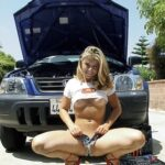 Blonde teen in red high heels flash boobs as mechanic