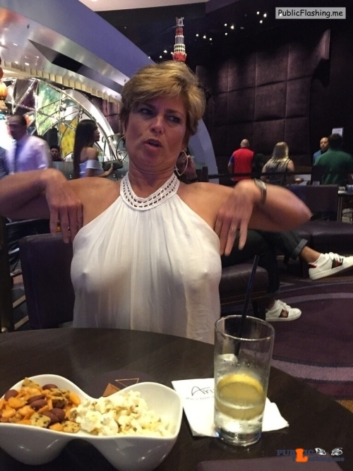 Exposed in public Braless MILF…