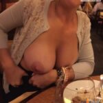Exposed in public sexxxaholic:Flashing the husband at dinner. The waiter caught…