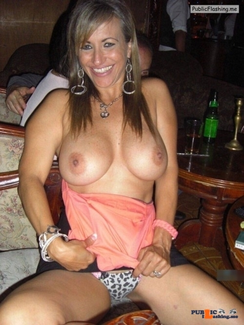Luxury lady is happy when topless in public