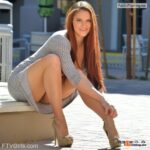 FTV Babes upskirt Curvy redhead in a killer dress and high heels gives us some…