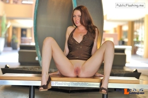 Public flashing photo flashingthepublic:This redhead doesn't like to be covered much….