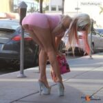Exposed in public Bimbo bending at the waist…panty flashing…